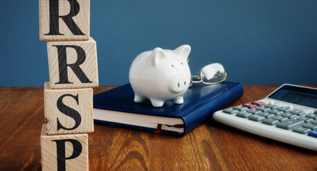 RRSP letter blocks on desk with piggy bank